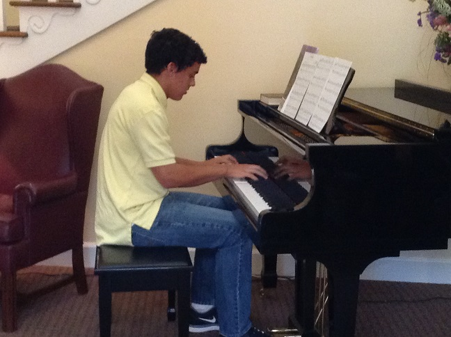Piano students volunteer in the West Cobb community.